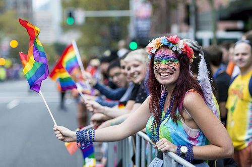 Woman Holding a Rainbow LGBT%2B Pride Flag at the Sydney Gay and Lesbian Mardi Gras Parade