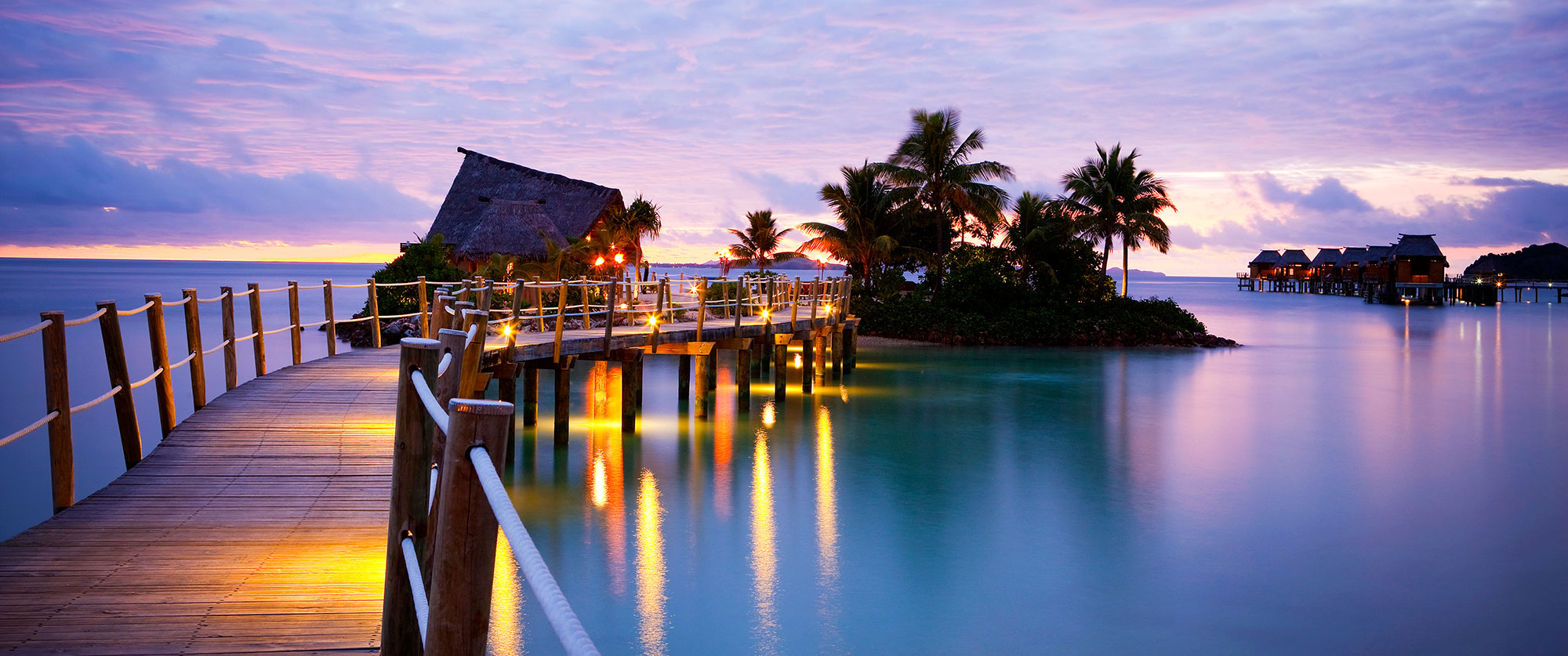 Fiji resorts fiji overwater bungalow likuliku lagoon for Nice places to go for honeymoon