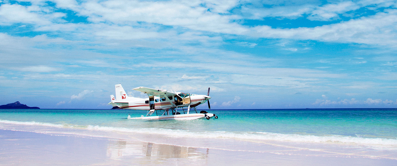 Seaplane Landing on Whitehaven Beach, Great Barrier Reef, Australia