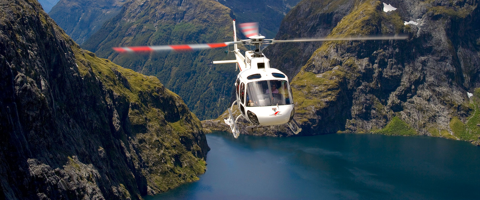 Indulgent Escape: New Zealand Luxury Vacation - Helicopter Over Milford Sound